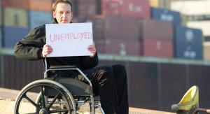"""Cittadino americano con il cartello """"disoccupato"""""""
